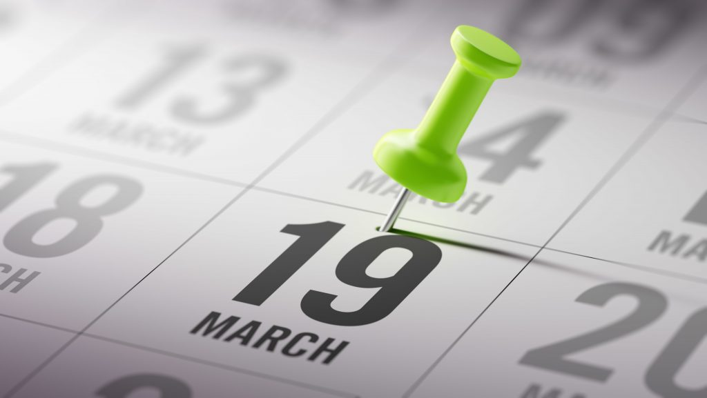 Calendar with push pin stuck on March 19th