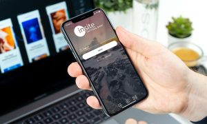 person holding phone with mobile banking app open